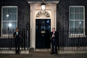 Prime Minister Boris Johnson of Britain applauding in support of the National Health Service in London on Thursday night.Credit...Aaron Chown Press Association, via Associated Press
